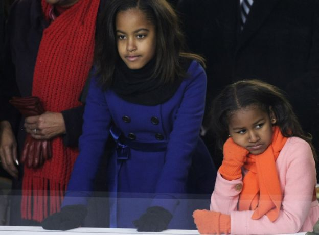Malia and Saha looking bored at Obama's swearing in ceremony