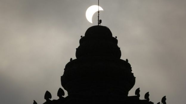 A partial solar eclipse is seen on the Independence monument in Phnom Penh, Cambodia, 09 March 2016.