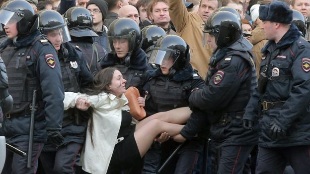 Russian riot policemen detain a demonstrator during an opposition rally in central Moscow, Russia, 26 March 2017