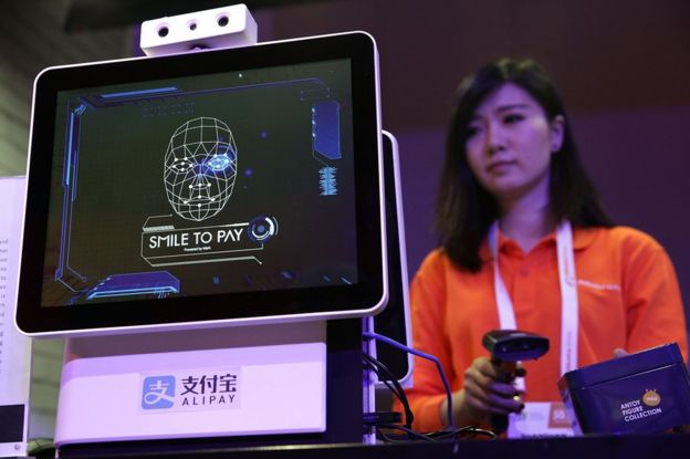 Woman demonstrating Alipay facial recognition technology