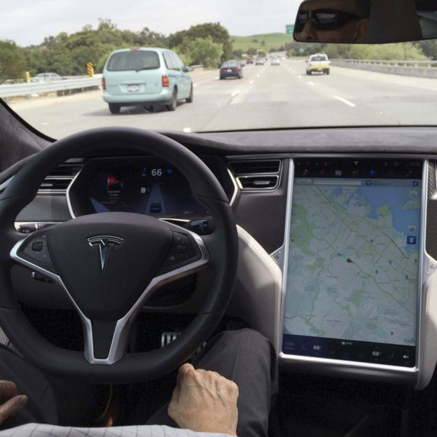 The interior of a Tesla Model S is shown in autopilot mode in San Francisco, California, U.S., April 7, 2016.