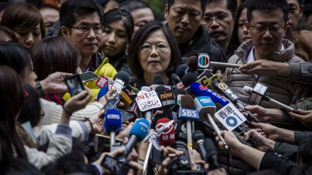 Democratic Progressive Party (DPP) presidential candidate Tsai Ing-wen, talks to journalists after casting her ballot at a polling station on January 16
