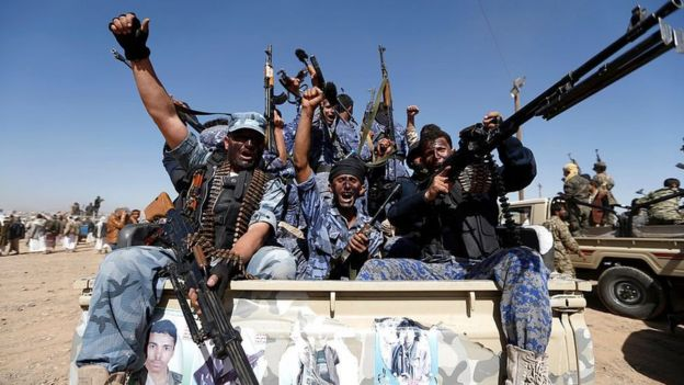 Newly-recruited Houthi fighters chant slogans as they ride a military vehicle in Sanaa on 3 January 2017
