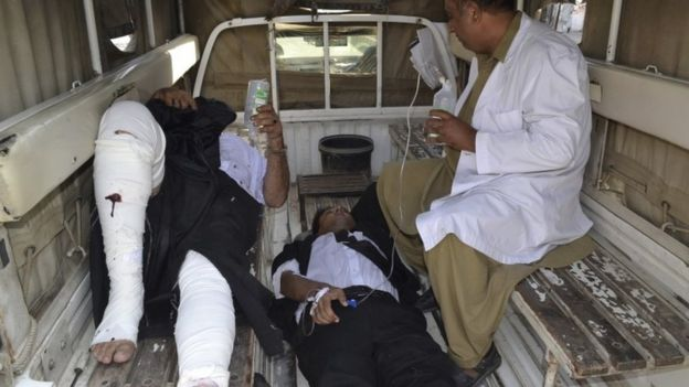 Injured lawyers receiving treatment in back of pick-up truck