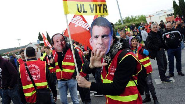 Union members wear masks of French leaders at a protest at an industrial area in Vitrolles, near Marseille, on 26 May 2016