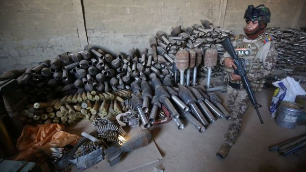 Iraqi soldier near weapons collected after IS was defeated in Falluja (file photo)