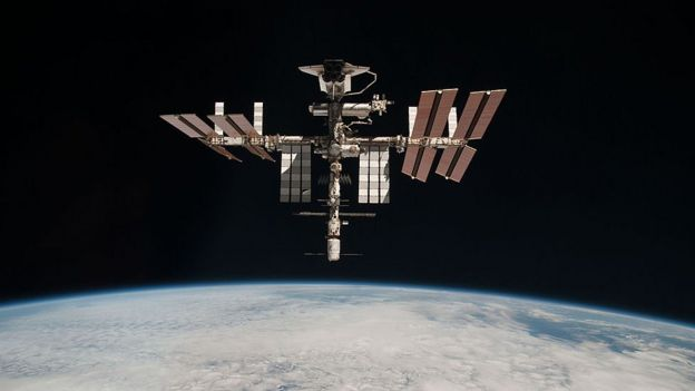 the International Space Station and the docked space shuttle Endeavour orbit Earth