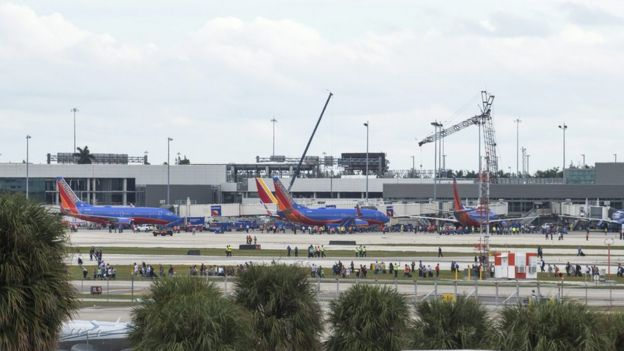 Hundreds of people are seen on the runway of Fort Lauderdale airport in Florida
