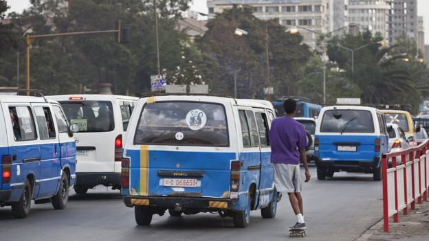 Minibus taxes on a street in Addis Ababa, Ethiopia