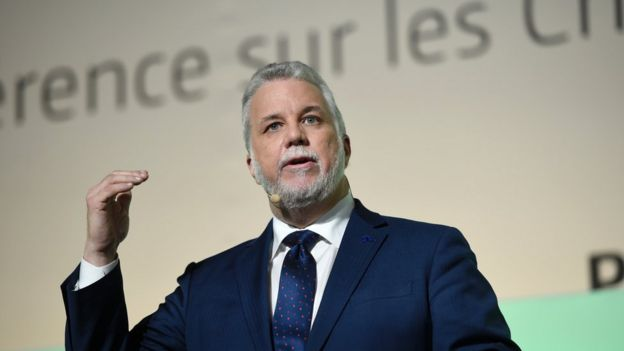 Quebec Premier Philippe Couillard delivers a speech during the opening of 'Action Day' at the COP21 United Nations conference on climate change in Le Bourget on December 5, 2015.