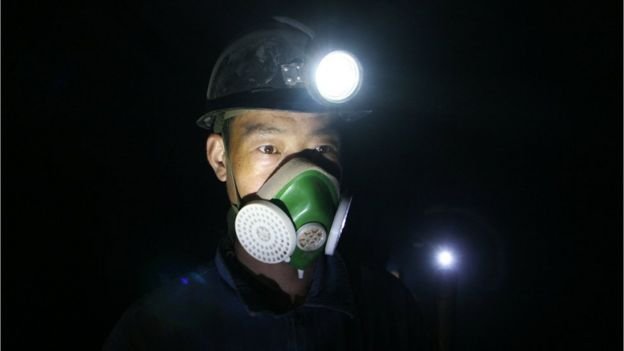 File image of a Chinese miner with a face mask on