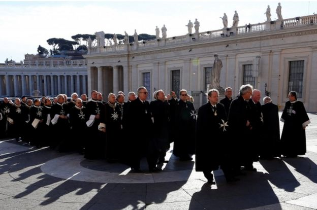 Members of the Order of the Knights of Malta arrive in St. Peter Basilica for their 900th anniversary at the Vatican February 9, 2013.