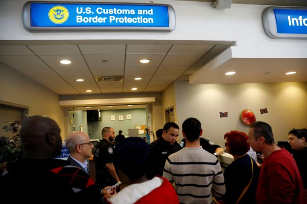 US Customs and Border Protection officers stand outside an office during the travel ban at Los Angeles International Airport (LAX) in Los Angeles, California., 28 January 2017