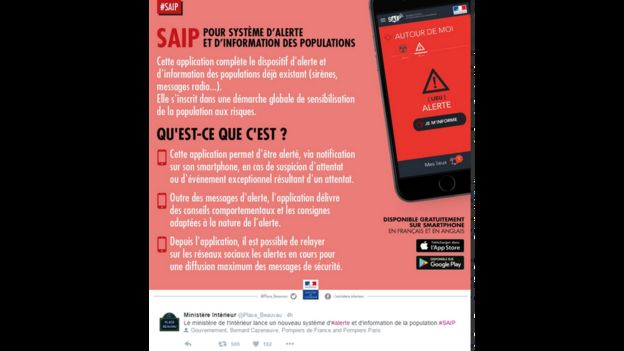 Promotional poster for the app posted on Twitter showing an iPhone with a full screen red alert