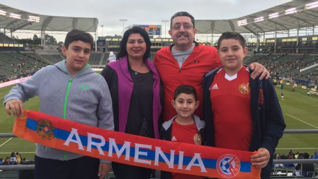 Sylvie and John Chatikachian pose with their family before the Armenia v El Salvador football match