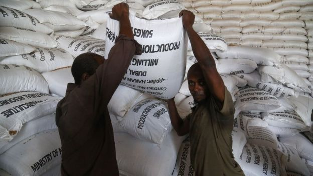 Workers moving sacks of food aid in Ethiopia