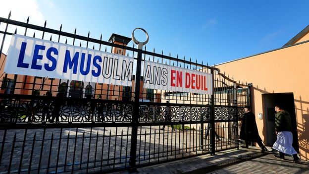 A banner displayed outside the Reims mosque after the Paris attacks reads