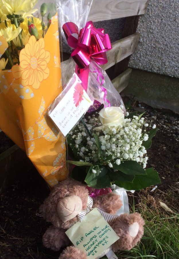 Floral tributes Pic: Brian Innes