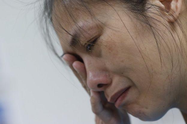 Ms Chien's colleague Winnie Lai in tears
