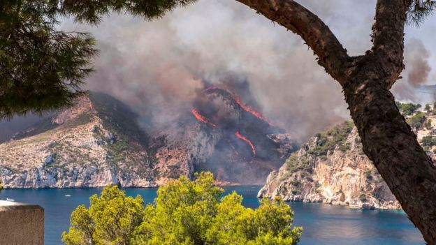 Handout photo taken with permission from the Twitter feed of @eltel63 of a wildfire raging in Javea near Benidorm, Spain, that has forced the evacuation of around 2,000 people.