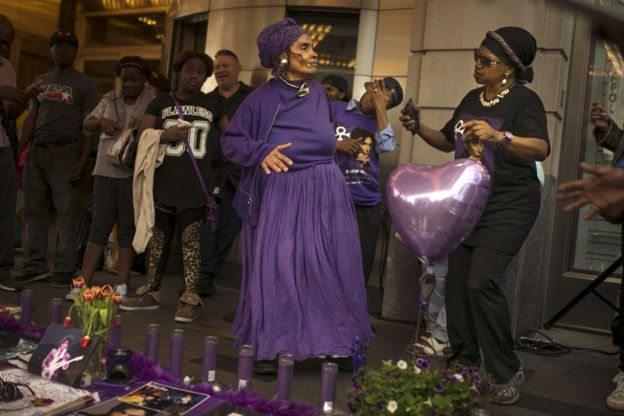 Fans gather and dance to Prince's songs outside the Apollo Theatre in New York, 22 April