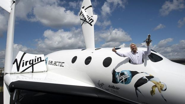 British billionaire Richard Branson in the window of a replica of Virgin Galactic, the world's first commercial space liner, Farnborough 2012
