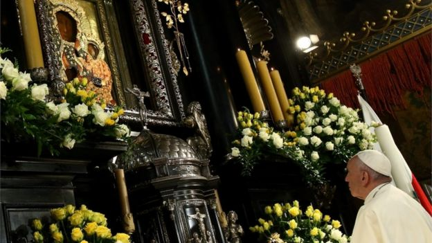 Pope Francis looks at the Black Madonna relic