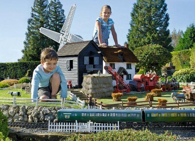 Children enjoy bekonscot - The tiny house village a miniature settlement ...
