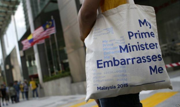 A Malaysian protestor carries a bag reading
