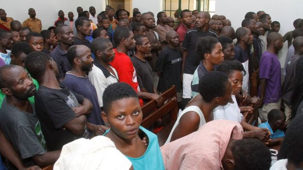 Defendants in court in Uganda.