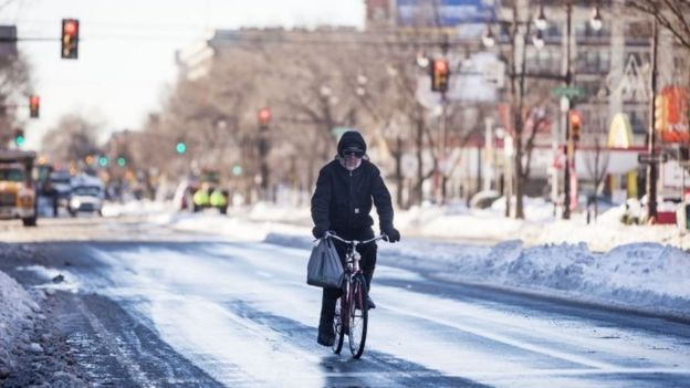 A man bikes down Broad Street in Philadelphia, Pennsylvania (24 January 2016)