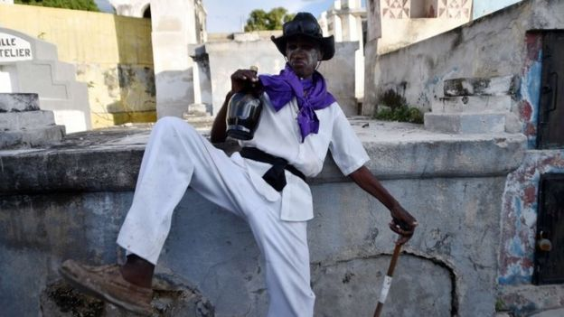 A voodoo devotee in the role of a spirit known as a Gede is seen during ceremonies honouring the Haitian voodoo spirits of Baron Samdi and Gede on the Day of the Dead in Port-au-Prince on 1 November, 2015.