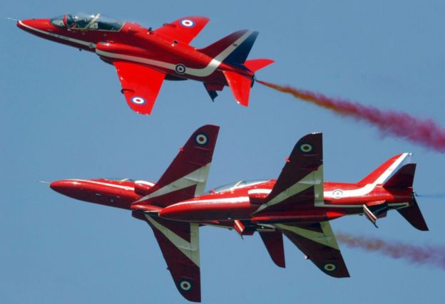 The Red Arrows display team demonstrate their close manoeuvres at the Farnborough air show, July 2004