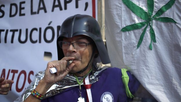 Marijuana supporter smokes outside of the Supreme Court in Mexico