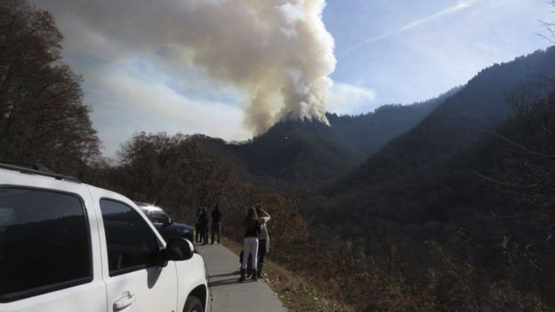Motorists stop to view the fires ahead of the evacuation order