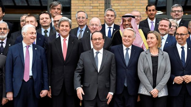 Left to right, front: Russian Ambassador to France Alexander Orlov, US Secretary of State John Kerry, French President Francois Hollande, French Foreign Minister Jean-Marc Ayrault, European Union Foreign Policy Chief Federica Mogherini, French State Secretary for European Affairs Harlem Desir and other foreign ministers and representatives gather for a group photo at the Middle East Peace Conference in Paris, France,