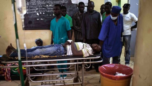 An injured protester on a stretcher in a hospital in Ouagadougou, Burkina Faso, 17 September 2015