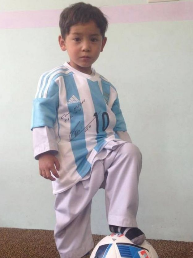 Photo of Murtaza Ahmadi in a signed shirt from Argentine striker Lionel Messi