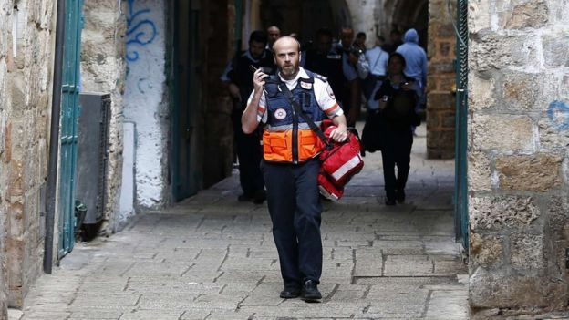 An Israeli medic walks down an alleyway in Jerusalem's Old City after a stabbing attack on 7 October 2015