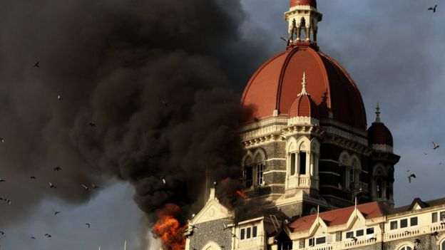Flames and smoke gush out of the historic historic Taj Mahal Hotel in Mumbai on November 27, 2008