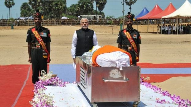 In this handout photograph released by the Indian Press Information Bureau [PIB) on July 30, 2015, PM Narendra Modi pays homage to former president APJ Kalam in Rameswaram