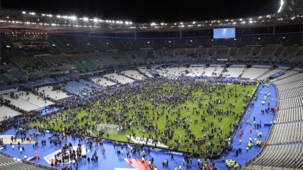Spectators invade the pitch of the Stade de France stadium after the international friendly soccer France against Germany