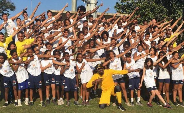 Jamaican athlete Usain Bolt with children in a Rio favela - 2 August 2016