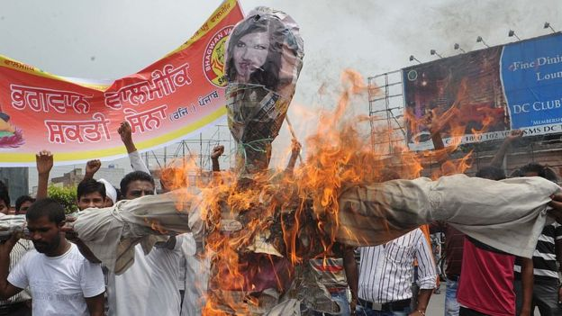 Activists of Bhagwan Valmiki Shakti Sena shout slogans against the film Jism 2, as they burn an effigy of actress Sunny Leone and director Pooja Bhatt during a demonstration in Amritsar on July 31, 201