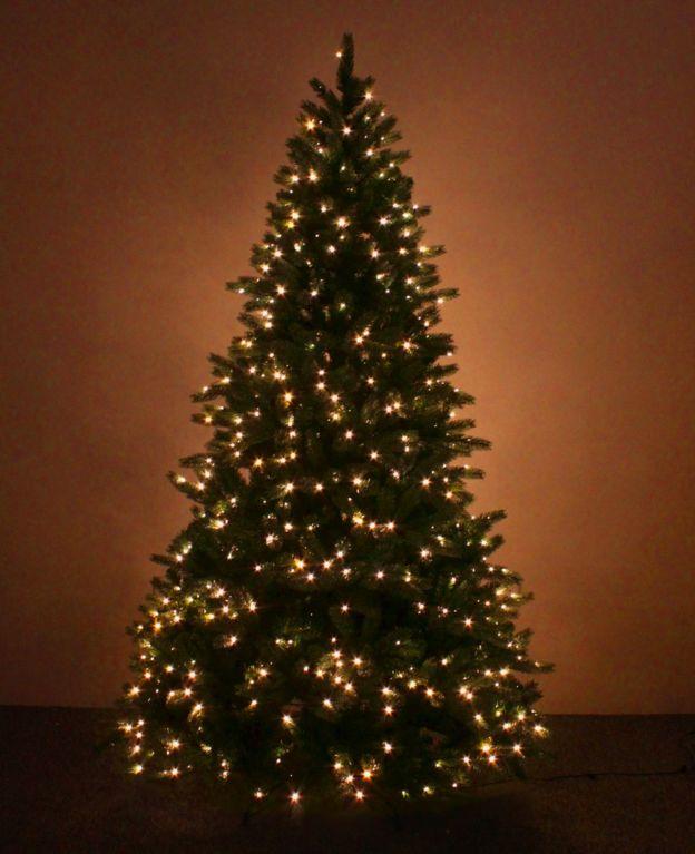 A pre-lit artificial Christmas tree