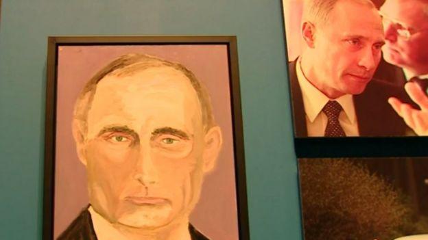 Портрет Путина кисти Буша