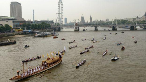 Royal barge Gloriana led a flotilla of boats down the River Thames