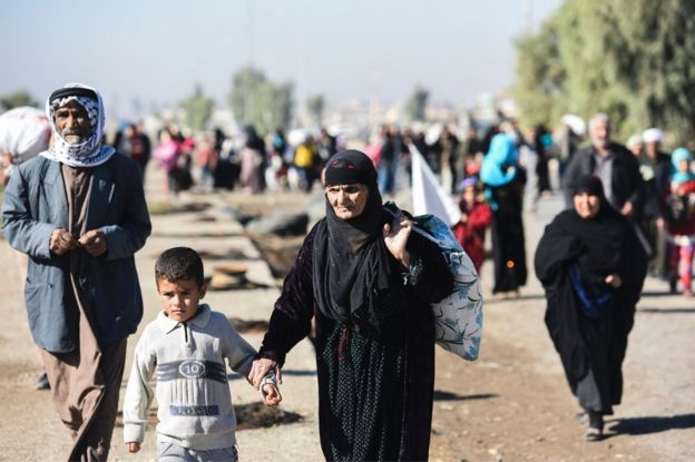 Civilians from eastern Mosul head to a camp for displaced people, 3 November