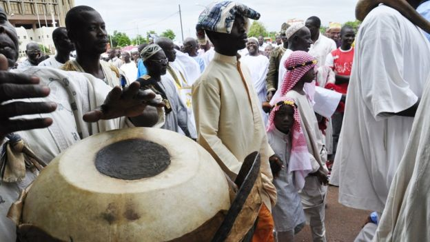 A man plays his drum during Eid celebrations in Ouagadougou, Burkina Faso