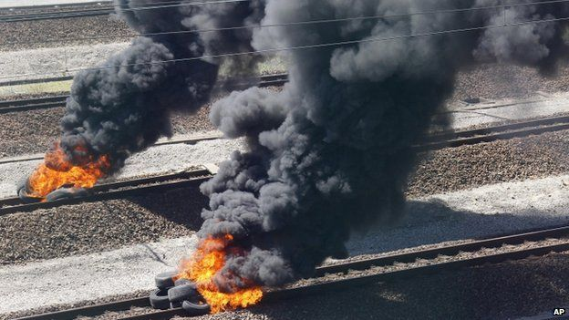 Burning tyres on Eurotunnel tracks near Calais
